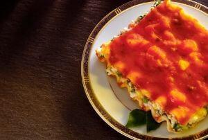 piece of pumpkin spinach and lentil lasagne