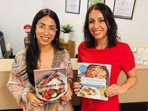Two Greek Girls Cooking